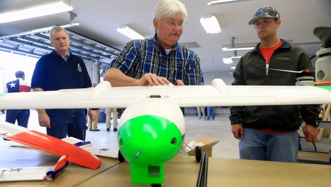 Maurice Griffin (center) prepares his drone for display during the 2017 Lone Star Drone Expo on Saturday, March 4, 2017, at Texas A&M University-Corpus Christi's Lone Star Unmanned Aircraft Systems Center of Excellence and Innovation in Corpus Christi.