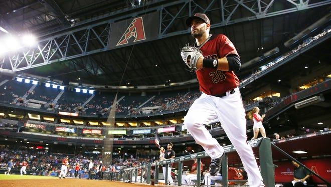 Arizona Diamondbacks' J.D. Martinez takes the field to play the Atlanta Braves on Wednesday, Jul. 26, 2017 at Chase Field in Phoenix, Ariz.