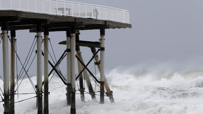 Support beams from a fishing pier lean onto others after breaking off from the platform as the effects Hurricane Jose hit Belmar on Tuesday.