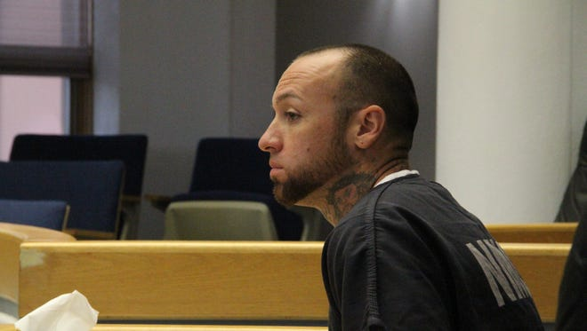 Michael T. Cox Jr. listens to court proceedings during his sentencing hearing in 12th Judicial District Court Tuesday.
