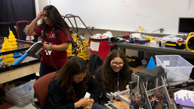 The Immokalee Robotics team gathers on Monday, Oct. 23, 2017, to tinker and improve the group's two robots used in competitions at Immokalee High School.