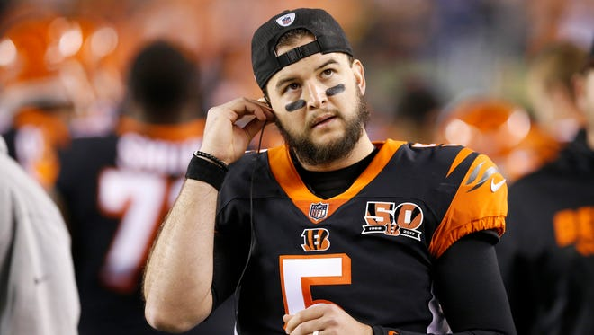 Cincinnati Bengals backup quarterback AJ McCarron (5) walks the sideline in the first quarter of the NFL Week 13 game between the Cincinnati Bengals and the Pittsburgh Steelers at Paul Brown Stadium in downtown Cincinnati on Monday, Dec. 4, 2017.