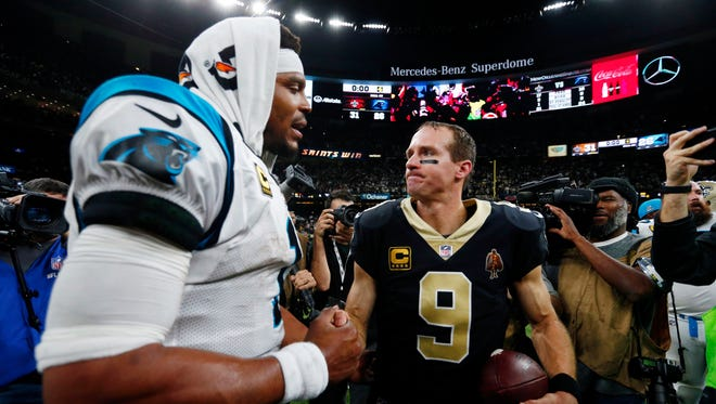 New Orleans Saints quarterback Drew Brees (9) greets Carolina Panthers quarterback Cam Newton after their NFL wild card playoff football game in New Orleans, Sunday, Jan. 7, 2018.
