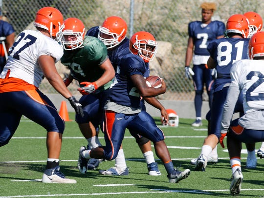 UTEP running Walter Dawn Jr., carries the ball through