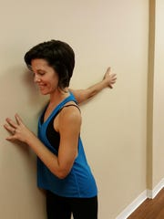 Aja Reeser at Yoga Bird, Fort Myers, shows the wall pose.