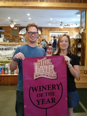 Hazlitt 1852 Vineyards was named winery of the year in the New York State Fair Commercial Wine Competition, judged in July at the state fair grounds. From left, are: Michael Reidy, vinifera winemaker, and Leah Hazlitt Triner, co-CEO of Hazlitt 1852 Vineyards.