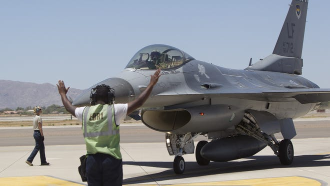 In a 2011 file photo, ground crew inspect an F-16 that recently landed at Luke Air Force Base in Glendale after a training exercise. On Tuesday, the pilot of an F-16C fighter jet safely ejected from the aircraft as it was forced to make an emergency landing at the Lake Havasu City Municipal Airport on Tuesday, officials said.