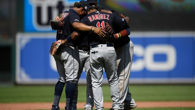 Cleveland Indians' Jose Ramirez (11), Francisco Lindor, left, and others huddle after a win in Baltimore. The Indians are in a fight for the postseason despite a frustrating season by the fans' standard.