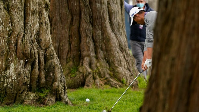 Collin Morikawa hits from the tress on the sixth hole during the final round of the PGA Championship golf tournament at TPC Harding Park Sunday, Aug. 9, 2020, in San Francisco.