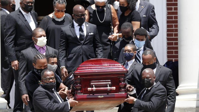 Rev. C.T. Vivian's casket is carried from Providence Missionary Baptist Church after his funeral service Thursday in Atlanta. Vivian, an early and key adviser to the Rev. Martin Luther King Jr., died last Friday at the age of 95.
