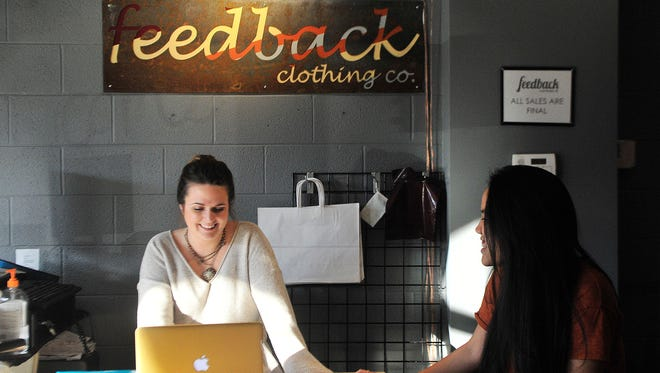 Belmont University sophomore Emily Gaus and junior Jennifer Mouthouta, both sales associates, work on homework between customers at Feedback Clothing Co., a retail space owned and operated by Belmont students.