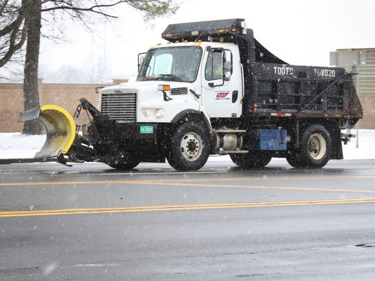 A Tennessee Department of Transportation truck salts