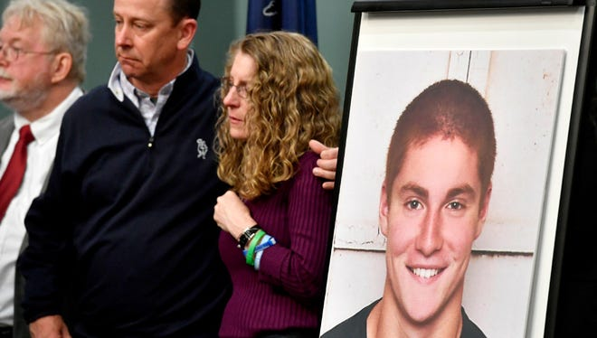 Jim and Evelyn Piazza stand by as Centre County District Attorney Stacy Parks Miller announces the results of an investigation into the death of their son Timothy Piazza, seen in photo at right, a Penn State University fraternity pledge, during a press conference on May 5, in Bellefonte, Pa.