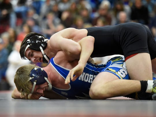 Annville-Cleona's Zach Renninger battles Northern Lebanon's Chase Bressler during the 145-pound match Wednesday night in Annville. Renninger won by pin in 5:38.