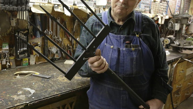 Steve Karow with one of his sturgeon spears that he made last year.  He has been making spears in his basement workshop and improving upon his original design for over 30 years, February 2, 2018.   Joe Sienkiewicz / USA TODAY NETWORK-Wisconsin