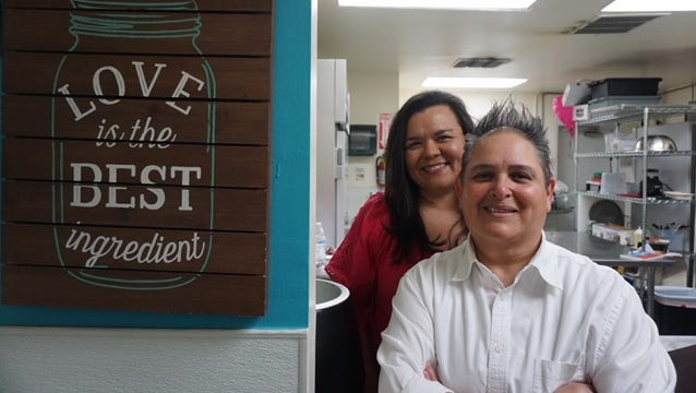 Robin Velasquez, left, and Laura Gonzales, right, co-own Laura's Burgers and More in Avondale.