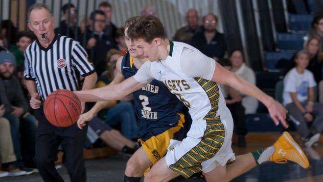 WOBM Boys  Basketball Final between Toms River North and Red Bank Catholic in Toms River  on 12/30/14. Peter Ackerman/Staff Photographer