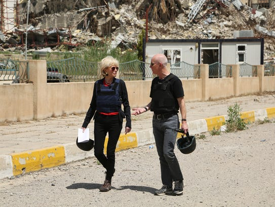 CBS journalist Lesley Stahl walks with the Rev. Columba