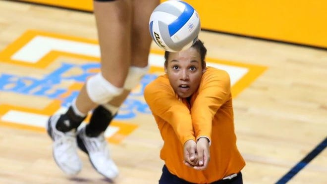 Defensive specialist Bridgette Villano of  Tennessee digs during a match against Mercer,