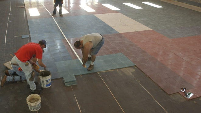 In this Daily Herald Media file photo from 2005, Wausau Tile workers install the new precast terrazzo flooring.