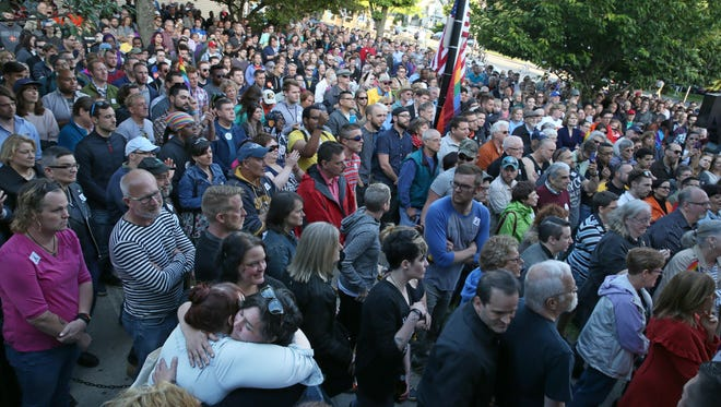 Hundreds attend a rally of support held for the victims of the Orlando mass shooting Monday night, June 13, 2016, at the Bachelor Forum on University Avenue in Rochester.