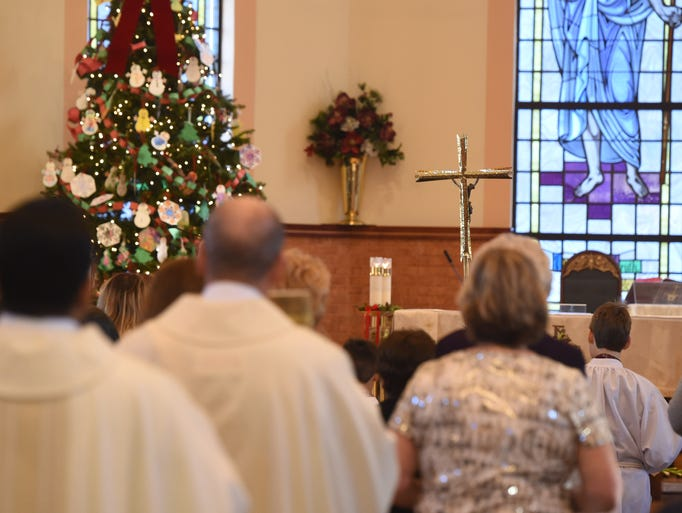 Scenes from Christmas Day Mass at St. Martin de Porres