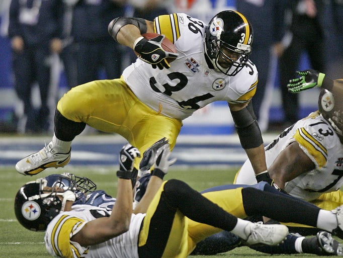 Steelers running back Jerome Bettis (36) is tripped
