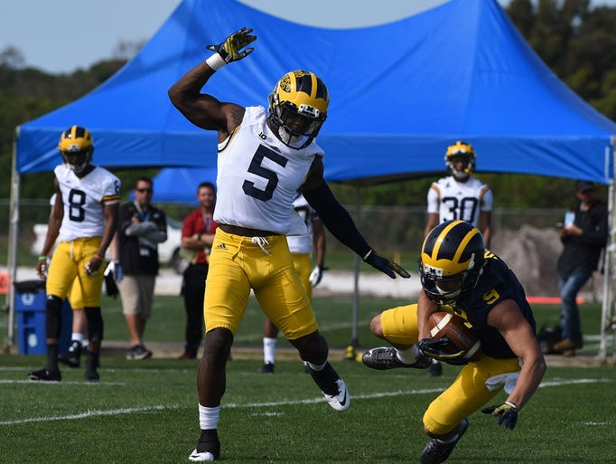 Michigan's Jabrill Peppers (5) covers wide receiver