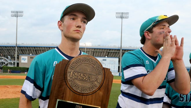 Siegel's Jacob Key holds the TSSAA Class AAA state championship trophy. He was named the District 7-AAA Pitcher of the Year.