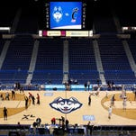 The Connecticut Huskies and the Cincinnati Bearcats warm up before the start of a game at XL Center on March 1.