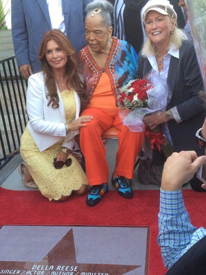 """Della Reese, center is flanked by """"Touched by an Angel"""" co-star Roma Downey, left, and actress Diane Ladd, Sunday during the unveiling of Reese's star on the Palm Springs Walk of Stars."""