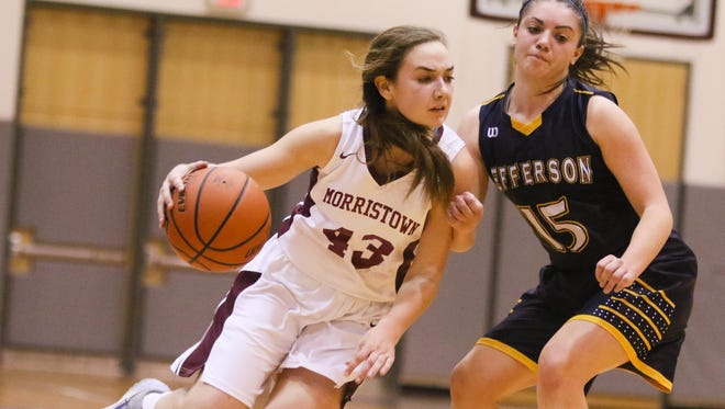 Morristown junior guard Elizabeth Strambi tries to drive past Jefferson's Ashley Hutchinson during the first half of the Morris County Tournament final.