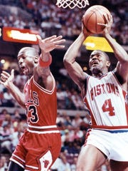 Pistons' Joe Dumars makes a layup against Bulls guard Michael Jordan in Game 7 of the East finals at the Palace on June 3, 1990.