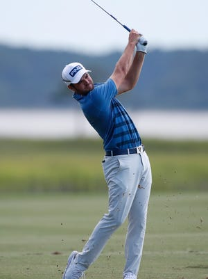 Corey Conners hits from the fairway on the 18th hole during the third round of the RBC Heritage golf tournament, held last month at Harbour Town Golf Links in Hilton Head, SC.
