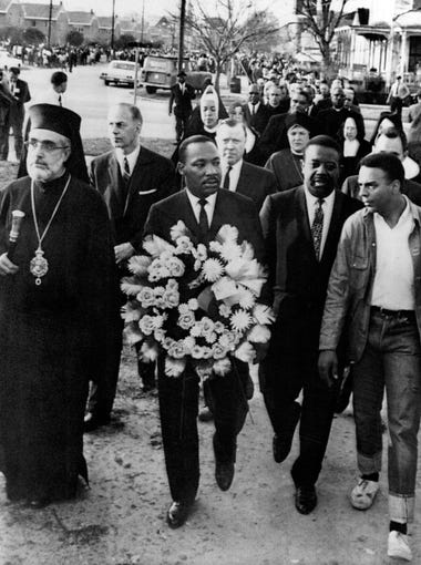 Civil rights leader Dr. Martin Luther King Jr. carries