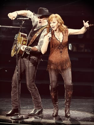 """Kix Brooks and Reba McEntire perform during the opening weekend of their residency """"Reba, Brooks & Dunn: Together in Vegas"""" with Ronnie Dunn (not pictured) at The Colosseum at Caesars Palace on June 19, 2015, in Las Vegas."""