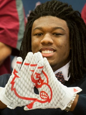 Park Crossing High School's PJ Blue announces that he is signing with Louisville at the Park Crossing in Montgomery, Ala. on Wednesday February 3, 2016.