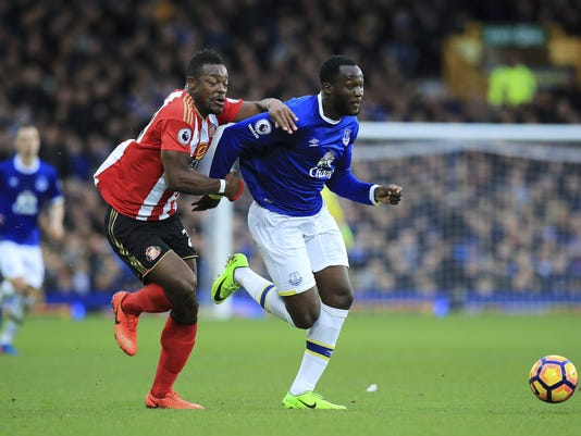 Sunderland's Lamine Kone, left, and Everton's Romelu Lukaku run after the ball during the English Premier League soccer match between Everton and Sunderland at Goodison Park, Liverpool, England. Saturday, Feb. 25, 2017.(/PA via AP)