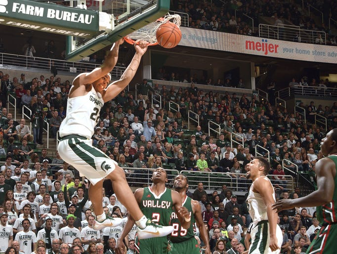 Michigan State freshman Miles Bridges slams the ball
