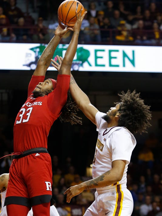 Rutgers forward Deshawn Freeman (33) grabs a rebound away from Minnesota forward Jordan Murphy (3) during the first half of an NCAA college basketball game Sunday, Dec. 3, 2017, in Minneapolis. (AP Photo/Bruce Kluckhohn)