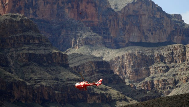 A Papillon Grand Canyon Helicopter flies in 2017 over the Colorado River through the Hualapai Reservation and the adjacent western part of Grand Canyon National Park.