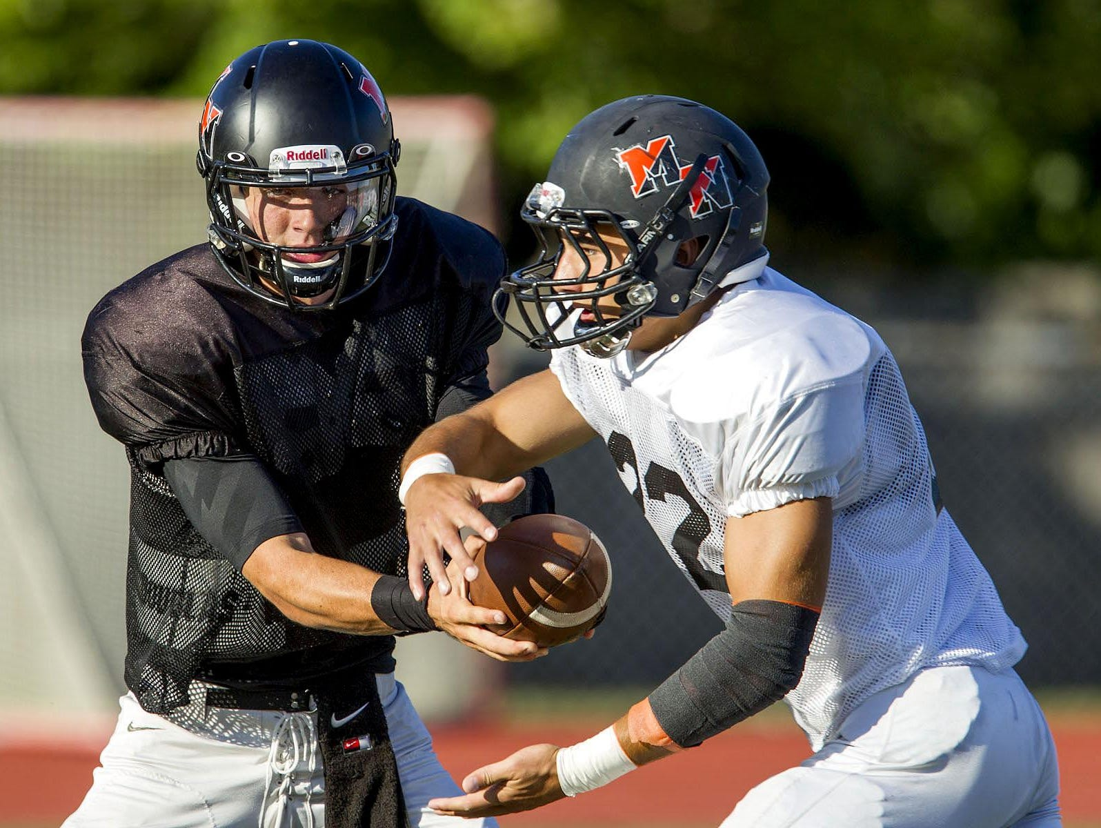 Middletown North's Donald Glenn hands off to Chad Freshnock during a scrimmage against Allentown last month.