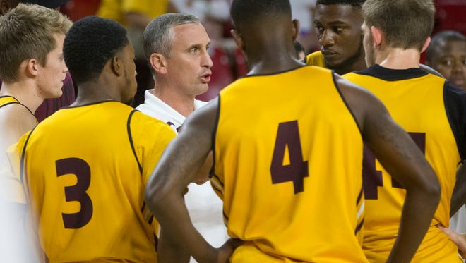 Arizona State basketball coach Bobby Hurley instructs his team during Maroon and Gold Madness at Wells Fargo Arena in Tempe on October 9, 2015.