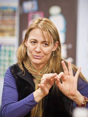 In this file photo, Sequoia Charter School for the Deaf and Hard of Hearing Deanne Bray-Kotsur uses American sign language in her Mesa, Arizona, classroom.