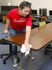 Wells Fargo employee Natasha Dianella works on cleaning up one of the computer areas at the Boys & Girls Club in Simi Valley as part of the United Way's Day of Caring on Saturday.