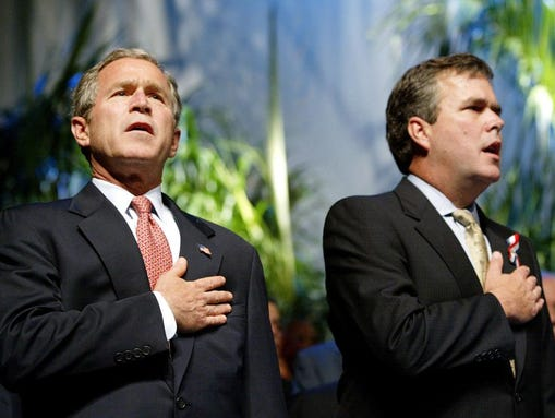 President George W. Bush is joined by his brother,