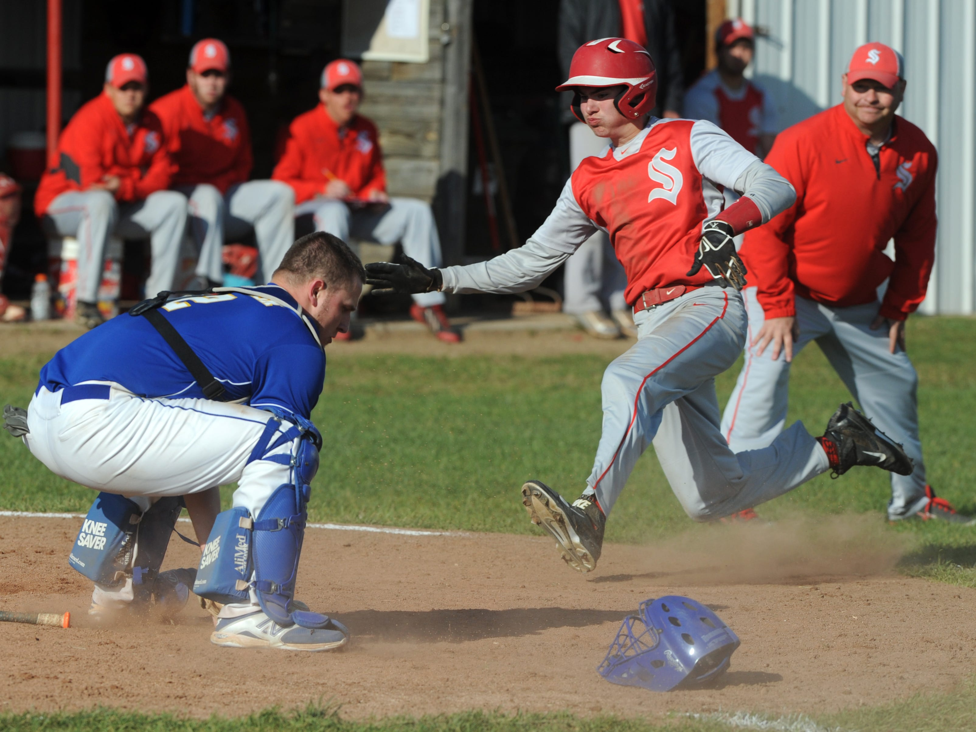 Sheridan's Collin Conrad races past Philo's Jacob Newton to score a run in the fifth inning of a game Thursday at Sheridan High School in Thornville.