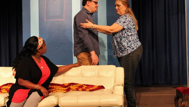 """Rosemary Bunther (Carolyn Ainsworth, right) talks to her son (Adam Singleton) while his wife Amy (Titania Inae) listens in this rehearsal scene from """"No Room For a Picture on the Blank Wall."""""""