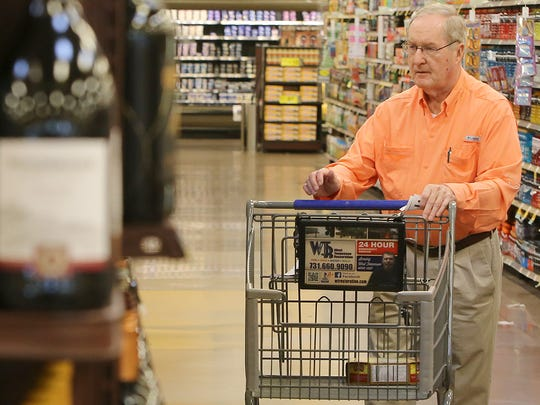 Charles Blankenship browses the wine selection at the Kroger on University Parkway, on Friday, July 1, 2016.