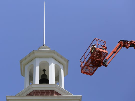 A worker makes his way to the top of Miller Tower on the campus of Union University on Tuesday, July 12, 2016.